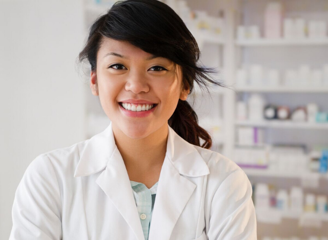 pharmacist smiling before administrating the HPV vaccine